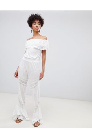 River Island Bardot beach jumpsuit with frill detail in